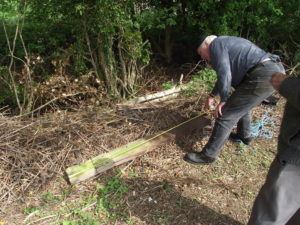 James measuring original SR fence post, to check spacing of timber rails