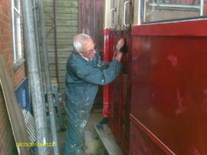 Bob preparing for the second coat of gloss - Coach 7
