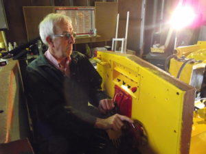 Bob tries the seat and the controls.  New electrical control panel evident