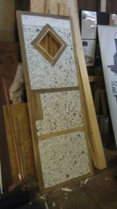 "The door with its ""John Bennett"" window (speckled finish is insulation)"