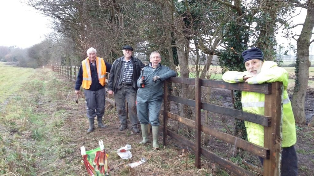 Volunteers at Wenhaston - new section of railway fencing - after a wet day