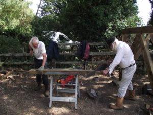 Carpenters John B and Bob both sawing an angled strut