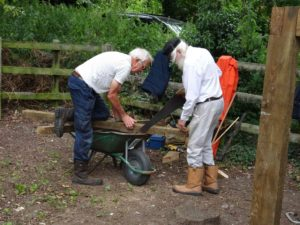 Sawing the sleepers for the pump platform - wheelbarrow a temporary workbench